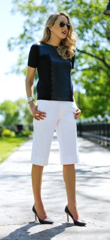 white cuffed gaucho pants, a navy scallop leather tee, classic pumps and silver jewelry