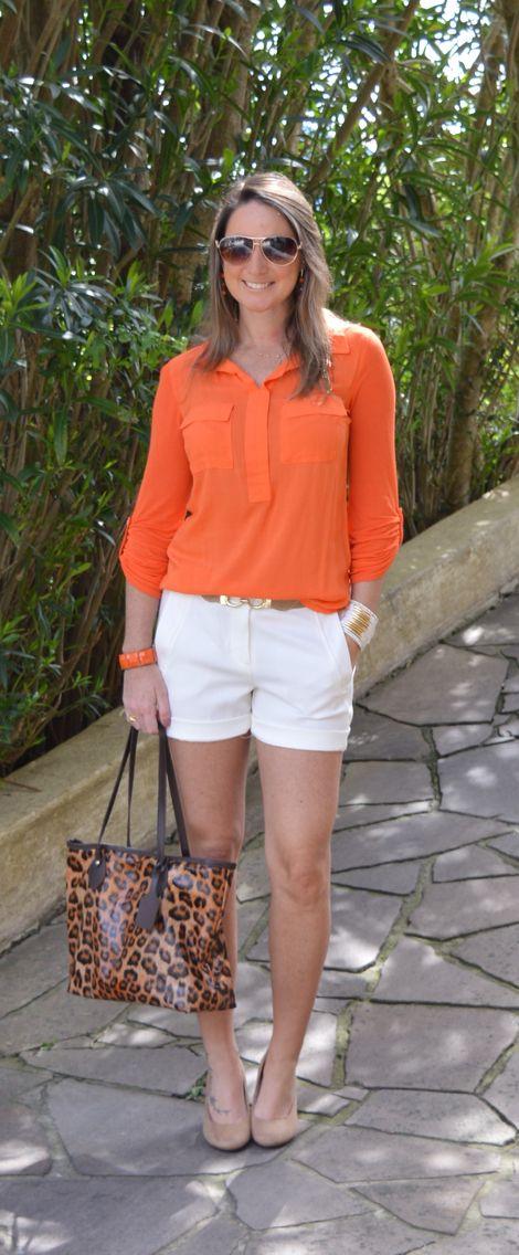 white shorts, an orange shirt, neutral heels and a leopard print bag
