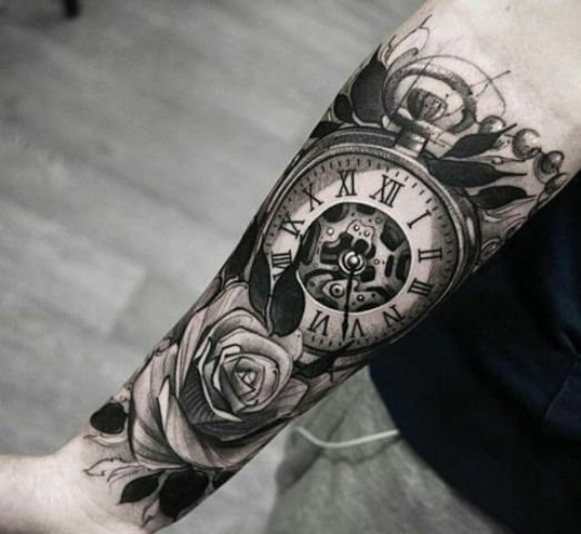 Big rose and clock tattoo on the arm
