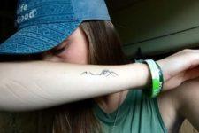Black-contour tattoo on the arm