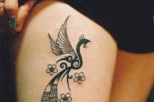 Black tattoo on the leg