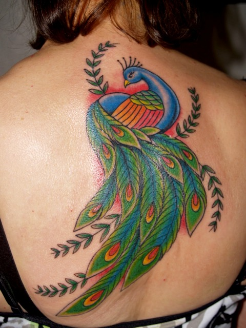 Picture Of Blue Green And Red Tattoo On The Back