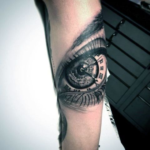 Clock and eye tattoo