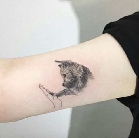 Cute dog tattoo on the arm
