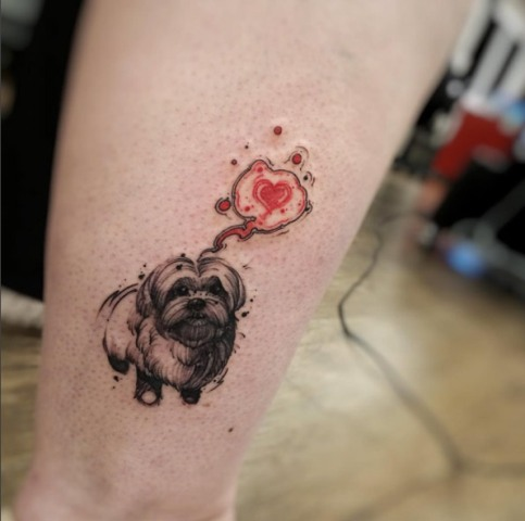 Dog and red heart tattoo