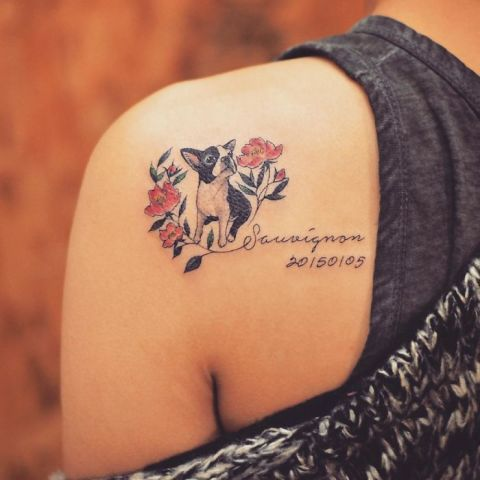 Dog with flowers and date tattoo
