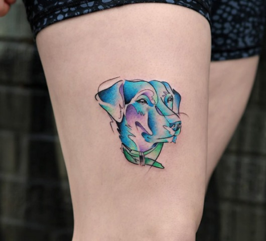 Excellent watercolor dog tattoo on the leg