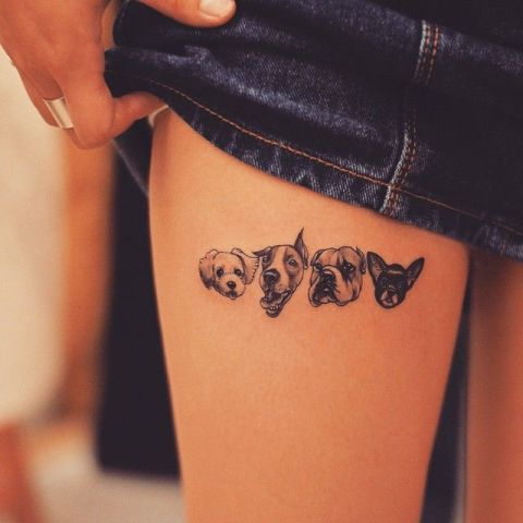 Four dogs tattoo on the leg