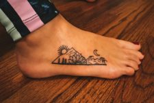 Funny tattoo on the foot