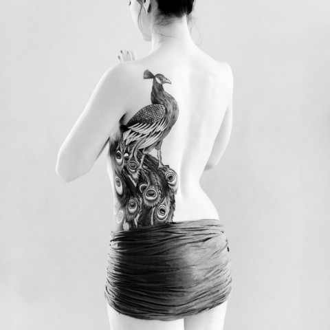 Gorgeous big tattoo on the back and left side