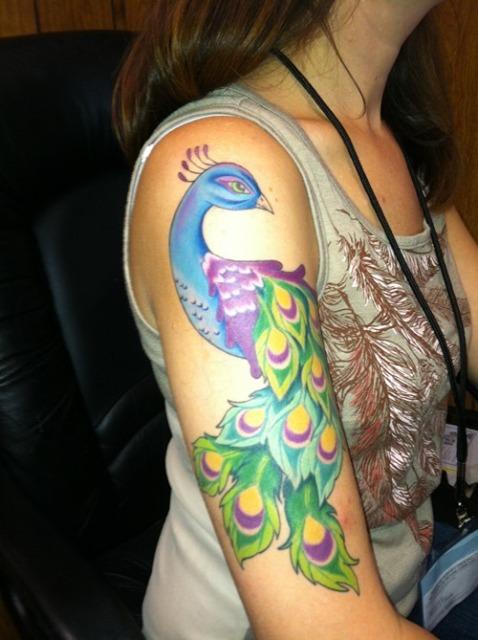 Half sleeve peacock tattoo