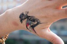Peacock head tattoo on the arm