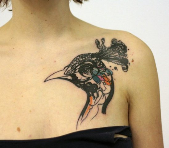 Peacock head tattoo on the shoulder