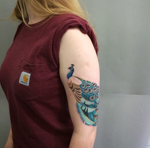 Peacock tattoo on the arm