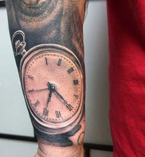 Realistic clock tattoo