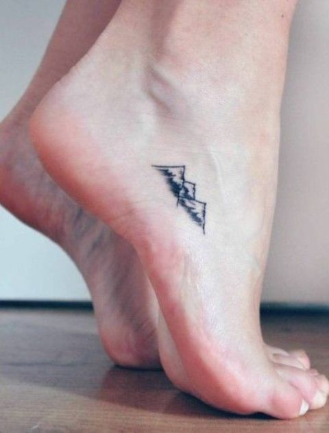 Tiny tattoo on the foot