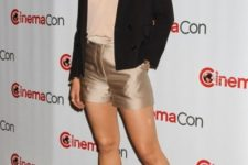 With beige blouse, black blazer and pale pink heels