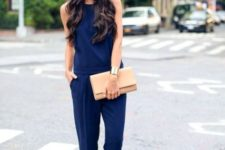 With beige clutch and nude sandals