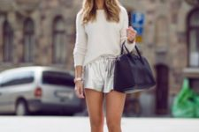 With beige shirt, metallic shoes and black bag