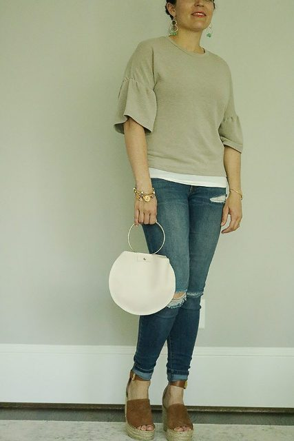 With bell sleeve shirt, skinny distressed jeans and brown sandals