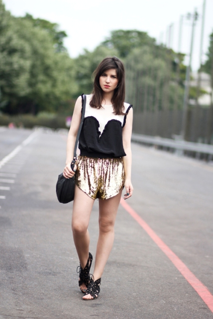 With black and white shirt, flat sandals and crossbody bag