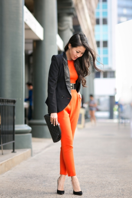 With black belt, blazer, pumps and clutch