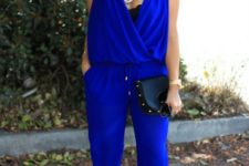 With black clutch and black sandals