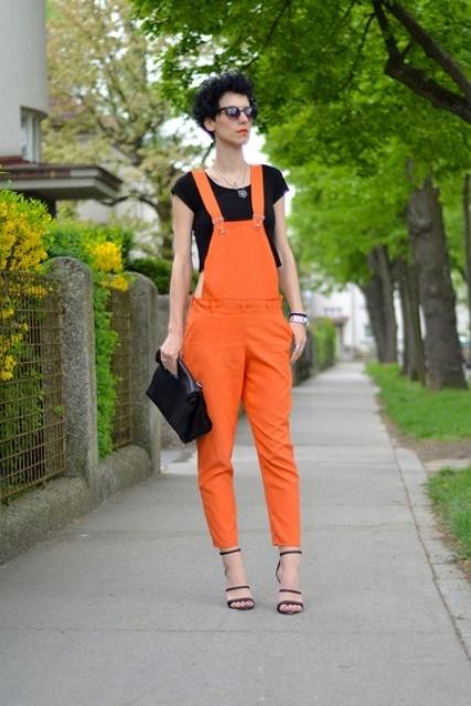 With black crop top, black clutch and heels