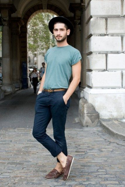With black hat, navy blue cuffed pants and t-shirt