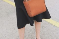 With black midi skirt and white flats