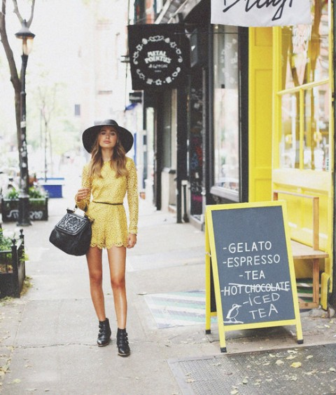 With black wide brim hat, ankle boots and bag