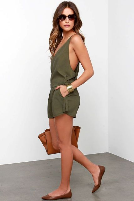 With brown flats and brown bag