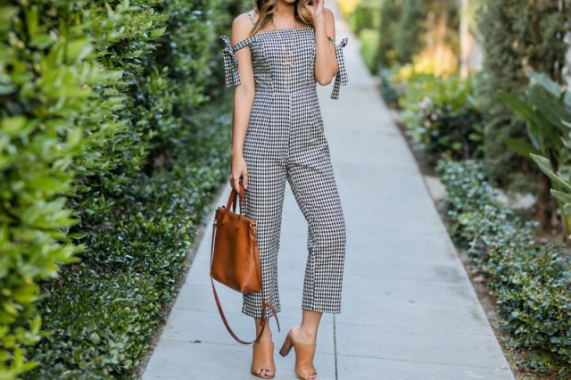With brown leather bag and light brown mules