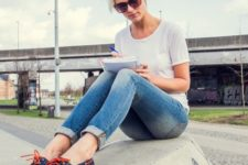 With classic white t-shirt and skinny jeans