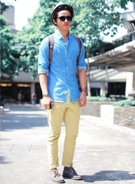 With denim shirt, yellow pants and hat