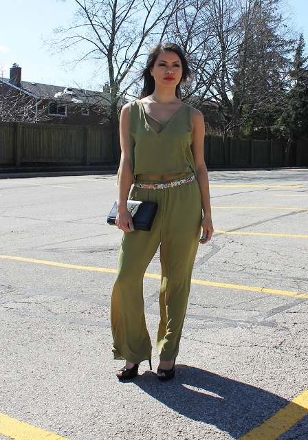 With floral belt, black heels and leather clutch