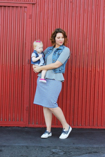 With gray peplum shirt, denim vest and striped skirt