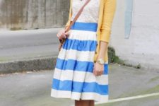 With lace top, yellow blazer, knee-length skirt and crossbody bag