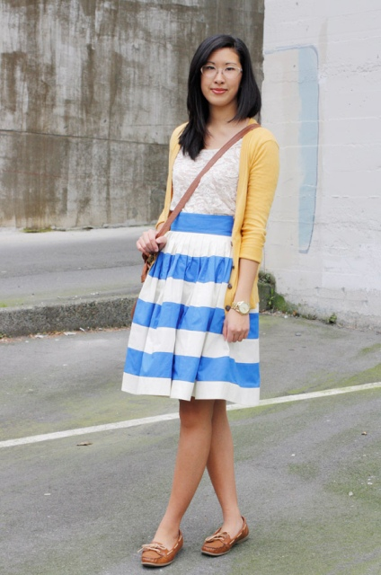 With lace top, yellow blazer, knee length skirt and crossbody bag