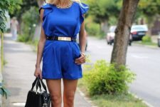 With lace up heels, black bag and golden belt