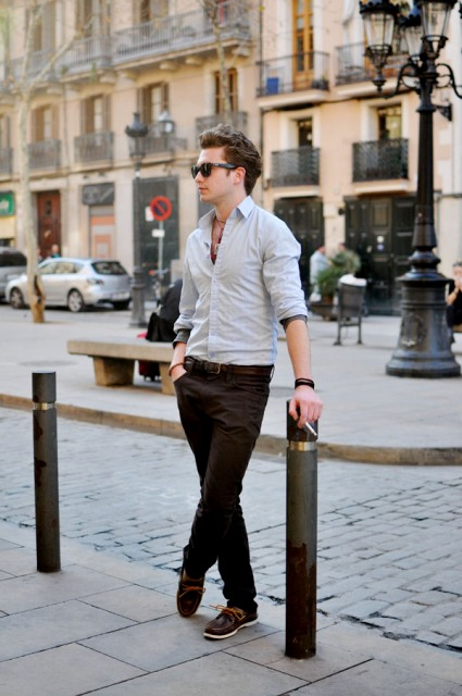 With light gray button down shirt and dark brown pants