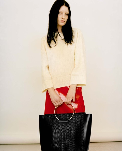 With light yellow blouse and red skirt