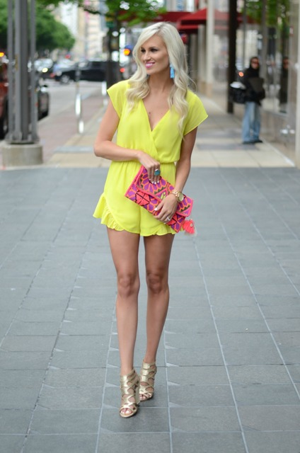 With metallic shoes and printed clutch