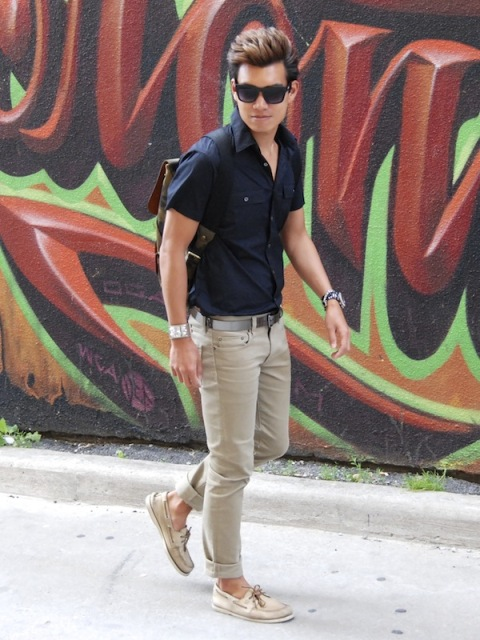 With navy blue shirt, gray trousers and backpack