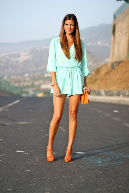With orange bag and sandals