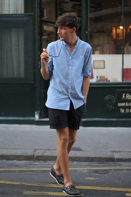 With pastel color shirt and black shorts