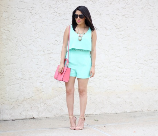 With pink bag, nude heels and statement necklace