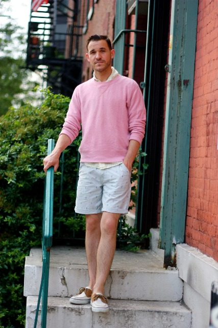 With pink sweatshirt and printed shorts