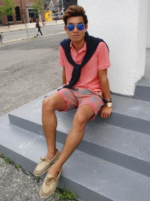 With pink t-shirt, printed shorts and black sweatshirt