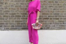 With printed clutch and beige sandals